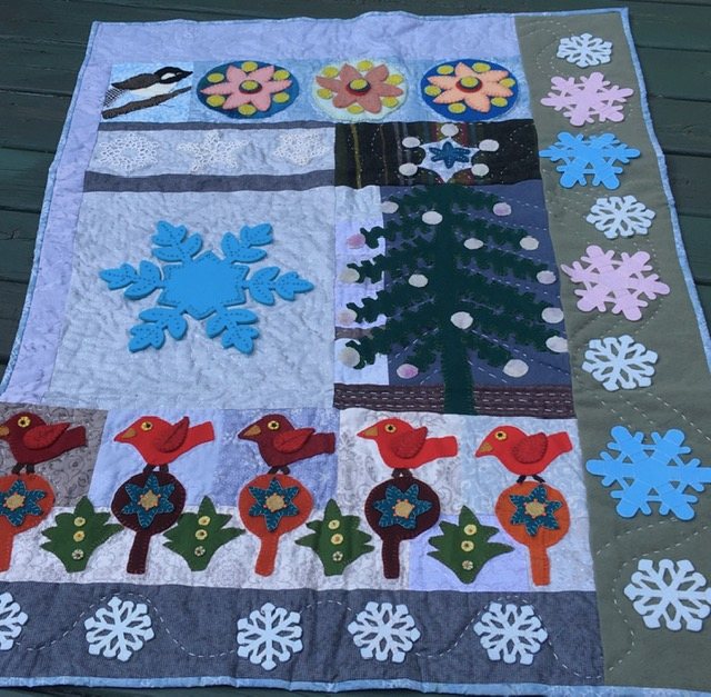 Ann P's adaption of Sue Spargo's Crimson Tide Christmas Quilt, changed to be a January quilt.