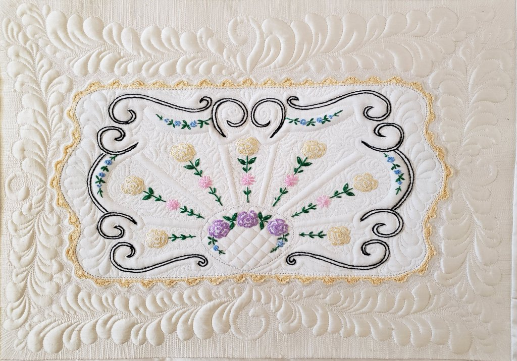 Janet H: Fun quilting up a vintage linen on silk.