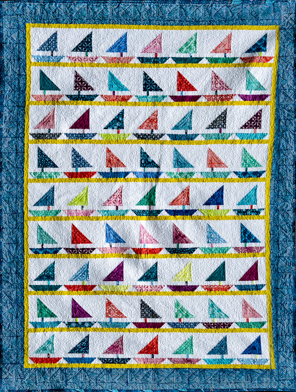 "Barb P: The Third quilt is for my grandson and is also twin size.  I call it ""Bay Regatta"" since they live in the San Francisco Bay area  quilted by Char Koppenol of Allendale."
