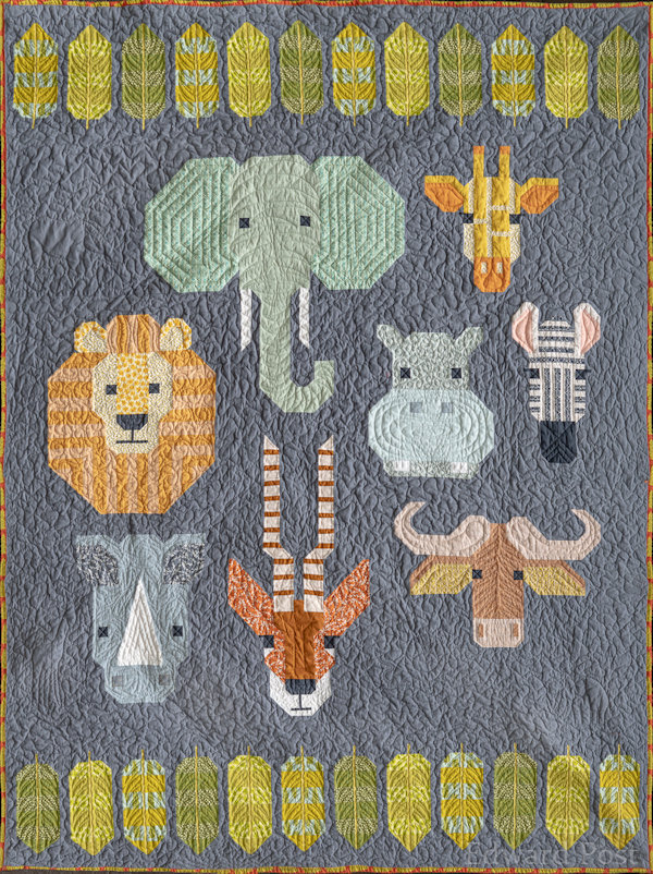"Barb P: This first quilt is for my granddaughter and is twin size.  I call it ""Out of Africa"" because of the safari animals.  quilted by Char Koppenol of Allendale."